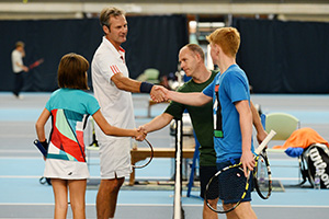 Players and parents shake hands after a Quorn Family Tennis Cup match