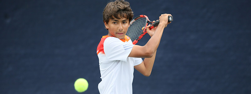 Junior plays a backhand during a competition