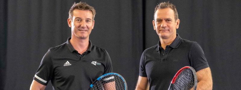 Scott Lloyd & Blane Dodds on court at net with tennis rackets.