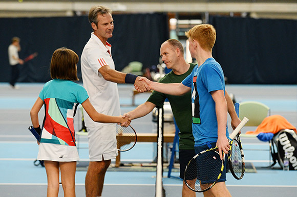 Tennis players shaking hands before a match