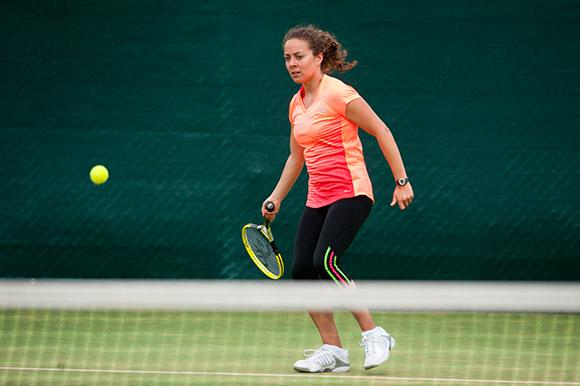 A woman hitting a tennis ball