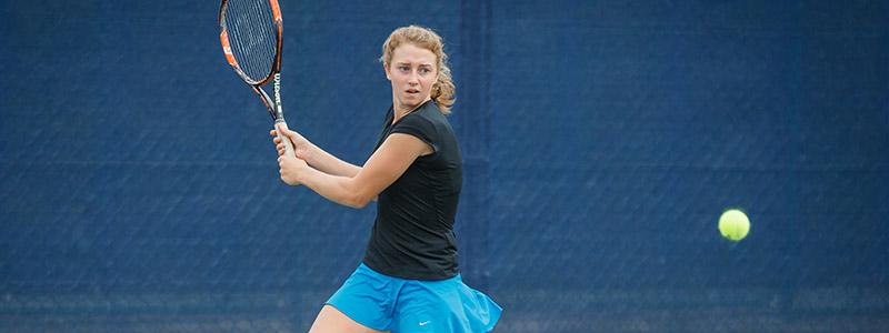 A girl hitting a tennis backhand