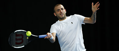 Dan Evans hits a forehand during the Battle of the Brits semi-final