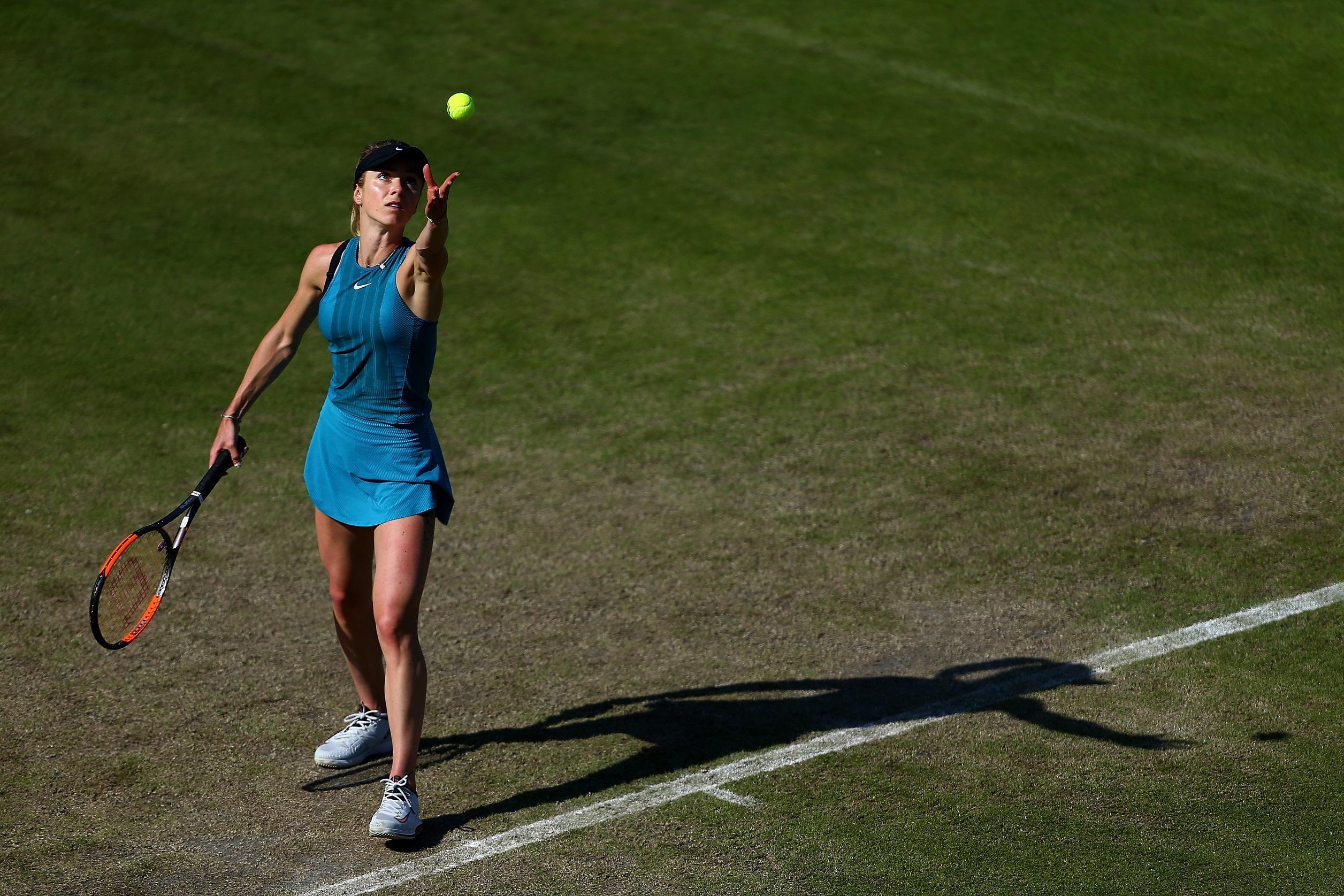 Elina Svitolina of Ukraine serves during her quarter-final match against Mihaela Buzarnescu