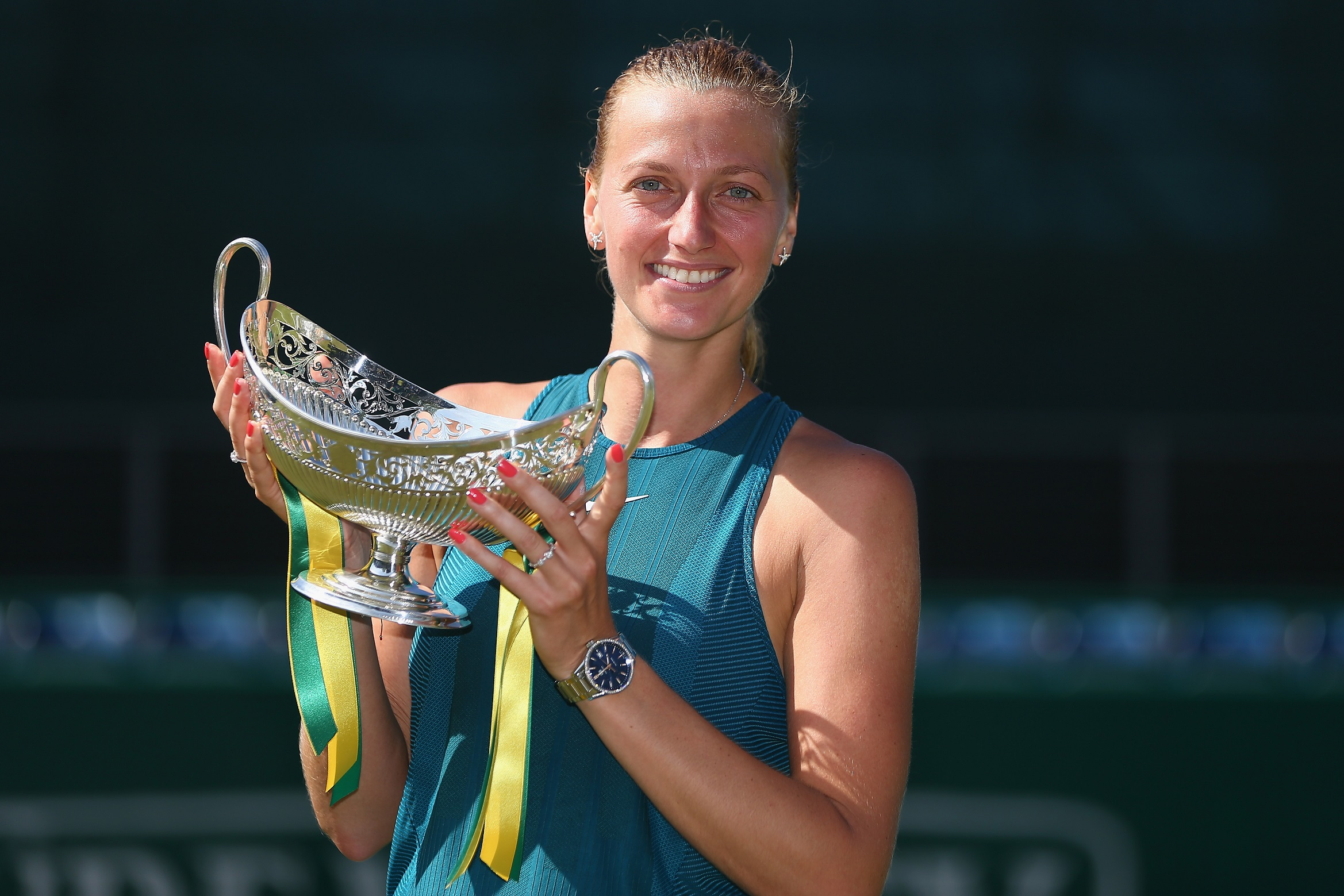 Kvitova of the Czech Republic poses with the Trophy