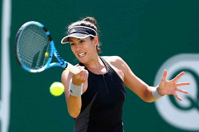 Garbine Muguruza plays a forehand
