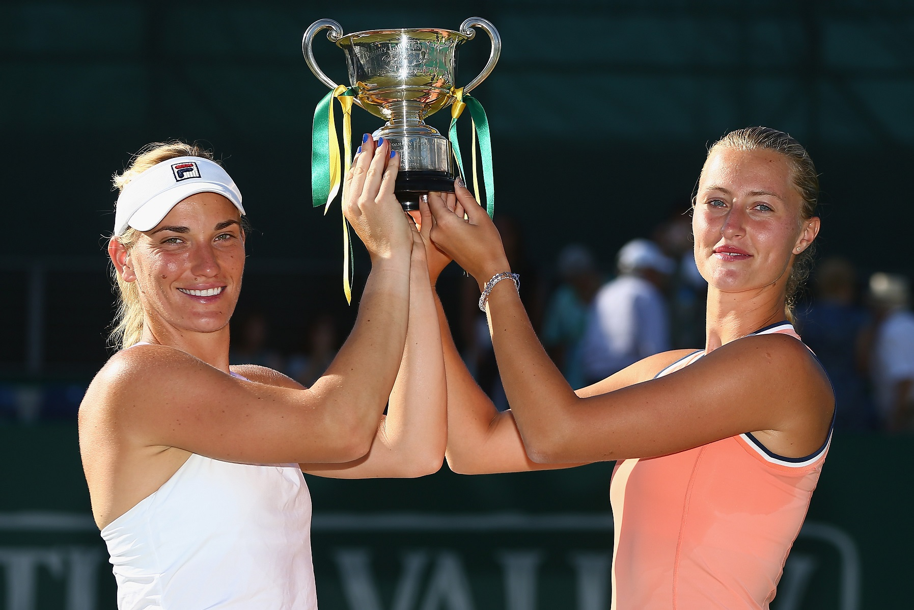 Imea Babos of Hungary and Kristina Mladenovic of France pose with the Trophy
