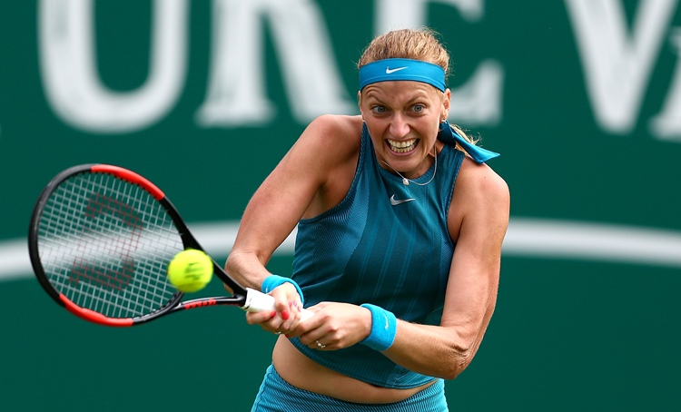 Petra Kvitova of plays a backhand during her first round match