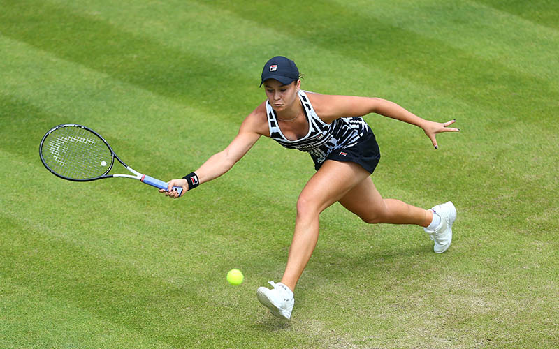 Ash Barty reaches for a forehand