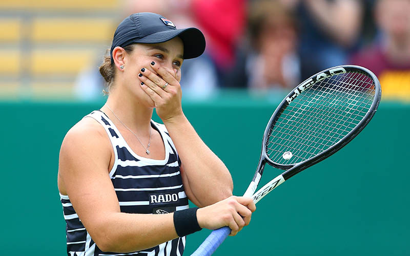 Ash Barty reacts after winning the title