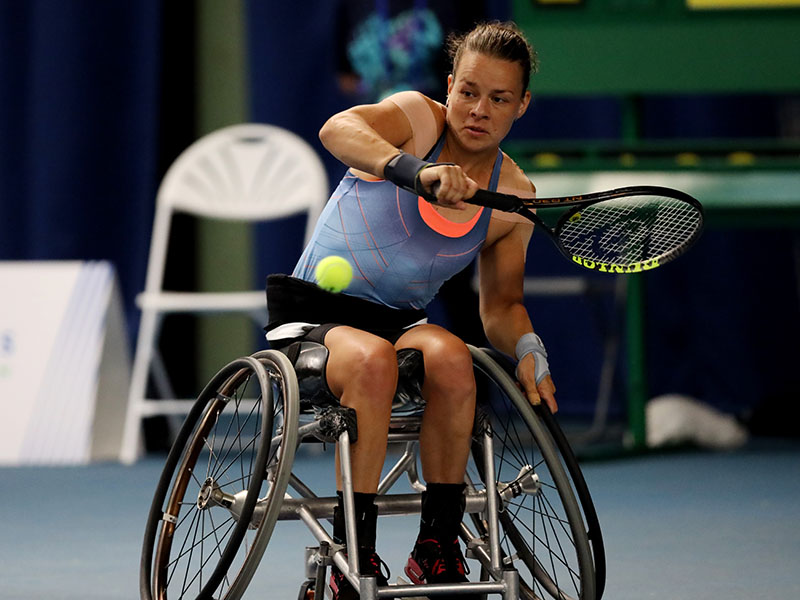 Marjolein Buis plays a forehand against Diede De Groot in the women's final