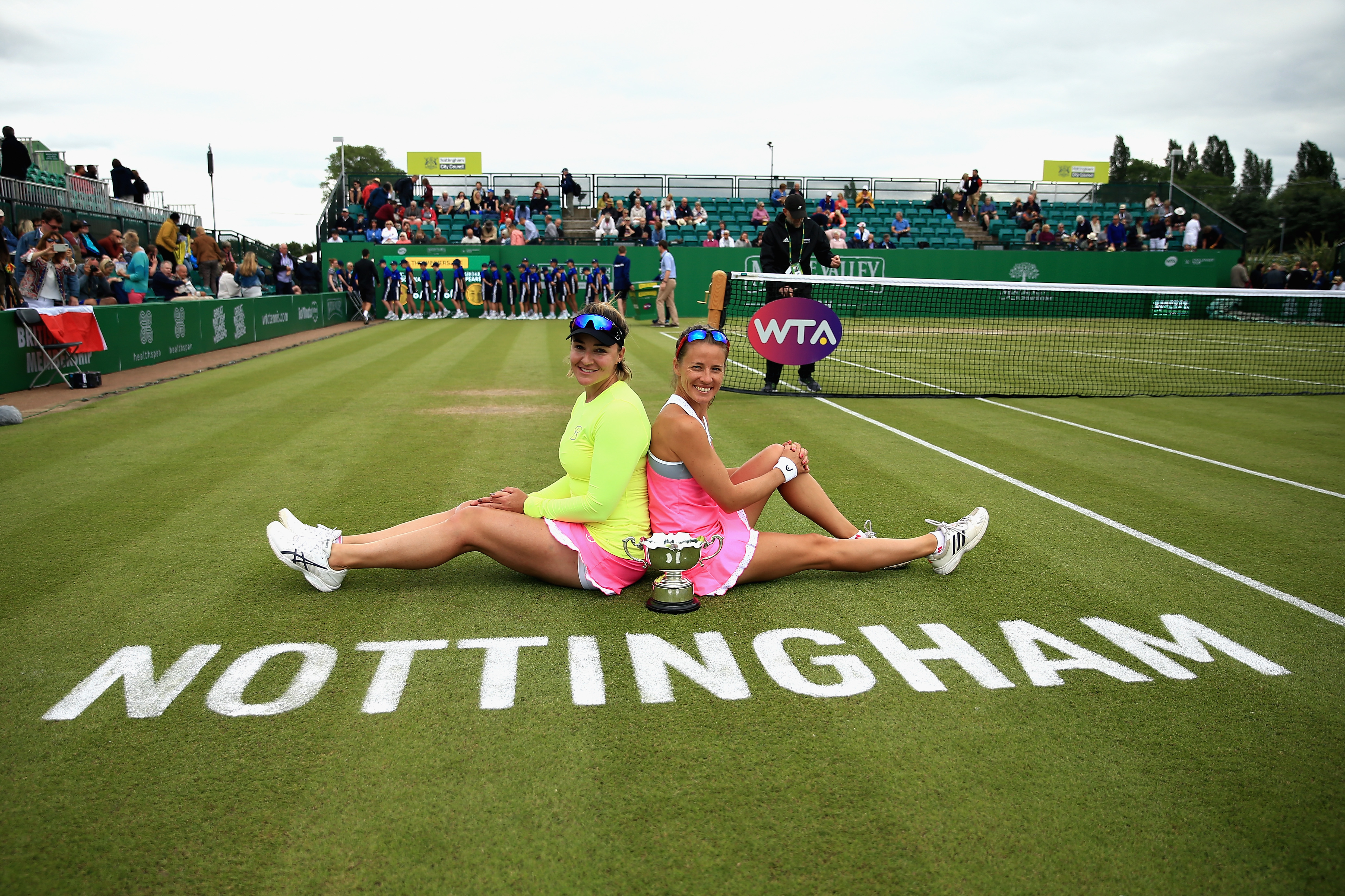 Alicja Rosolska of Poland and Abigail Spears of USA celebrate victory in the Womens Doubles Final