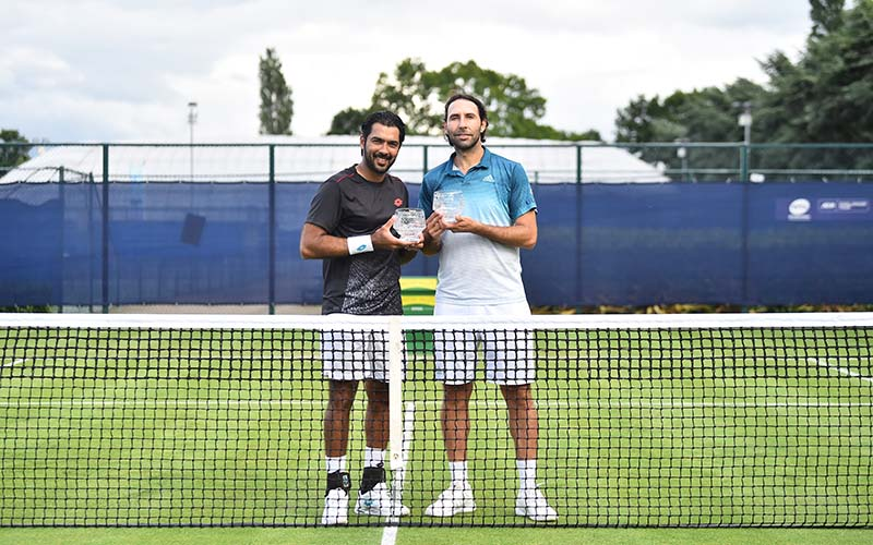 Santiago González and Aisam-ul-Haq Qureshi pose after winning the men's doubles