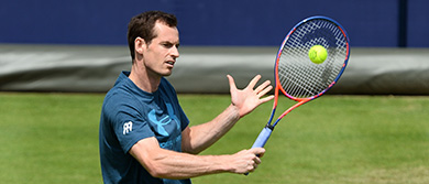 Andy Murray hits a backhand volley during practice at The Queen's Club