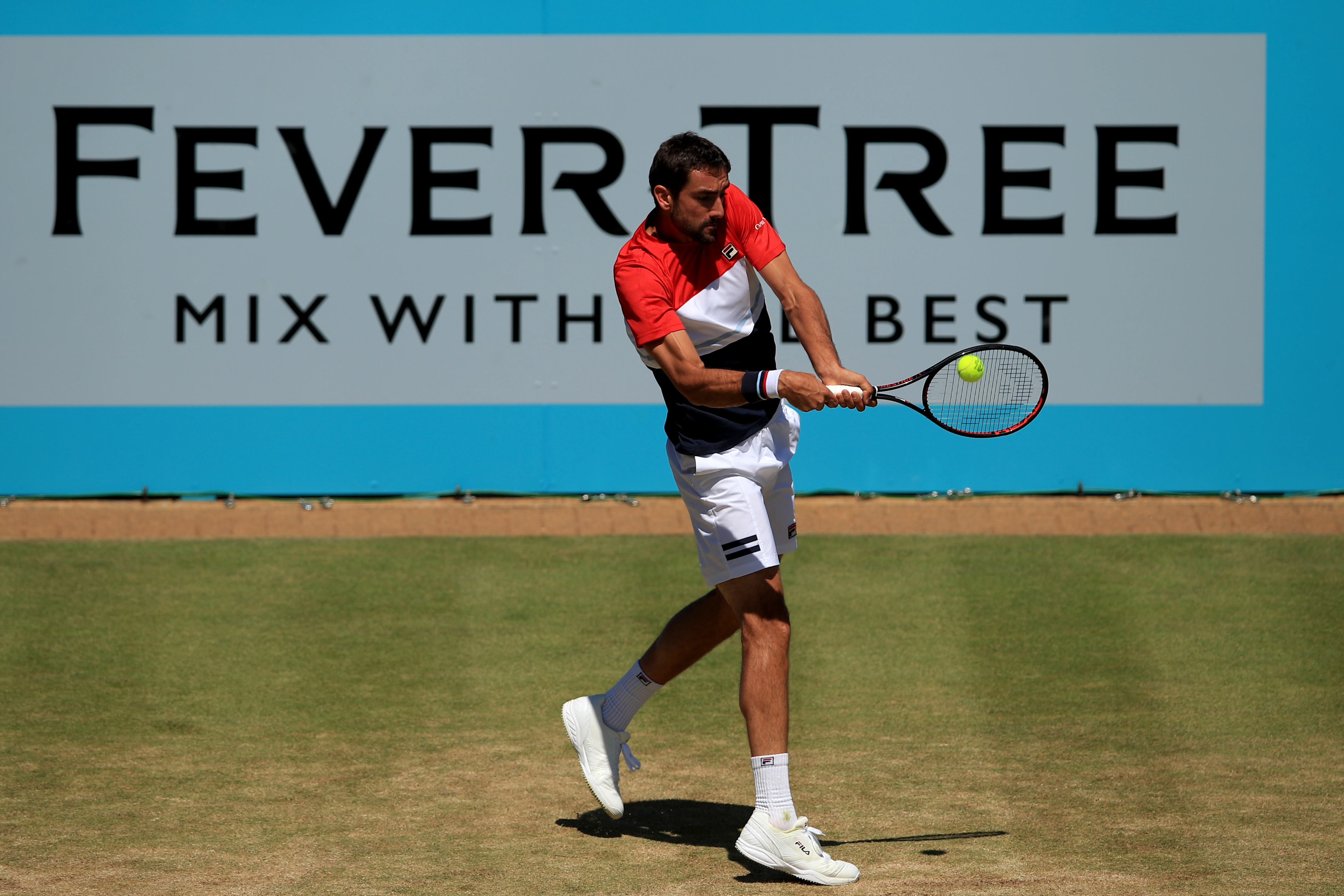 Marin Cilic striking a backhand in the quarter-final match against Sam Querrey
