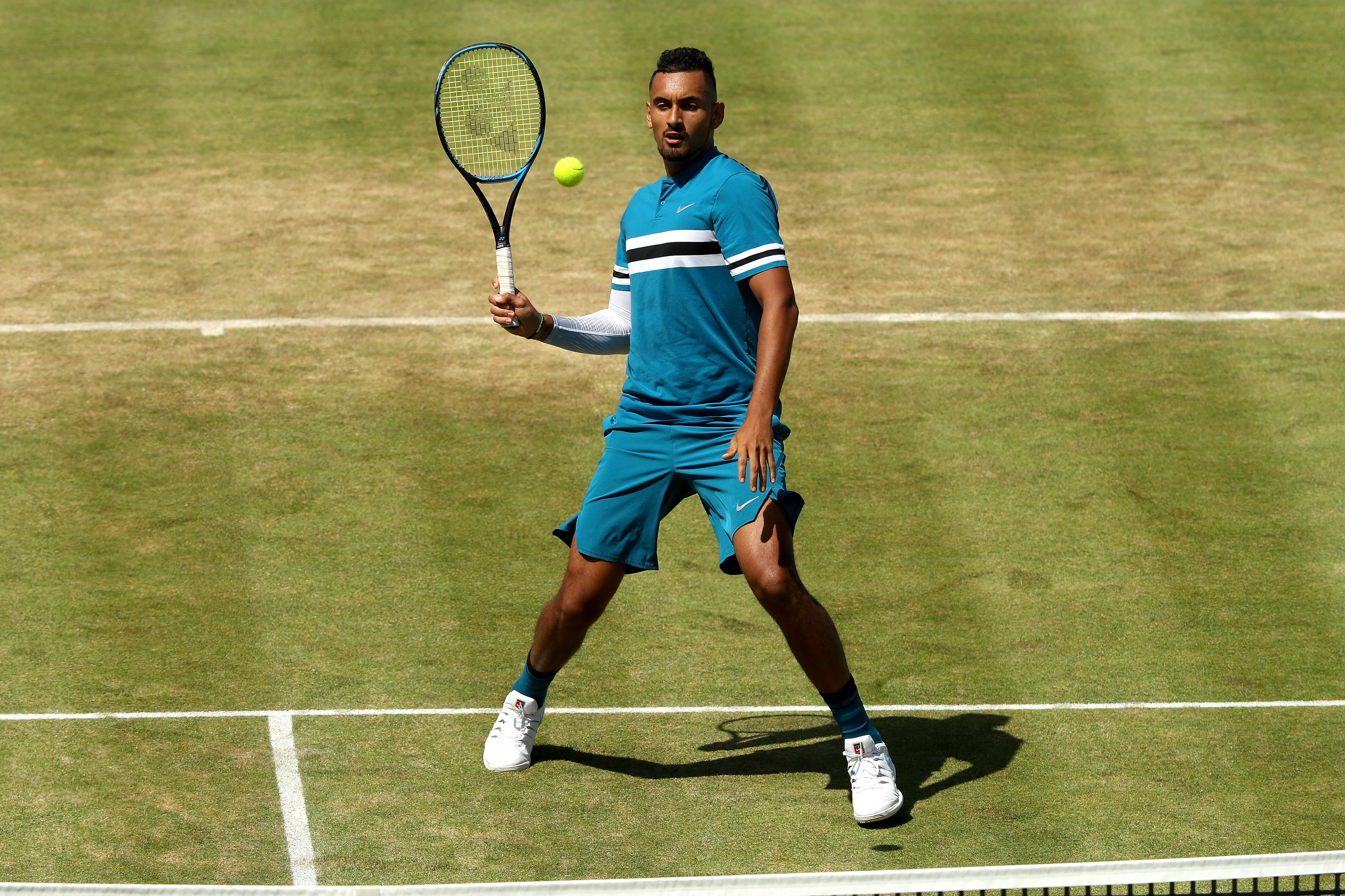 Nick Kyrgios dodges to make contact with a forehand volley against 2017 Champion Feliciano Lopez