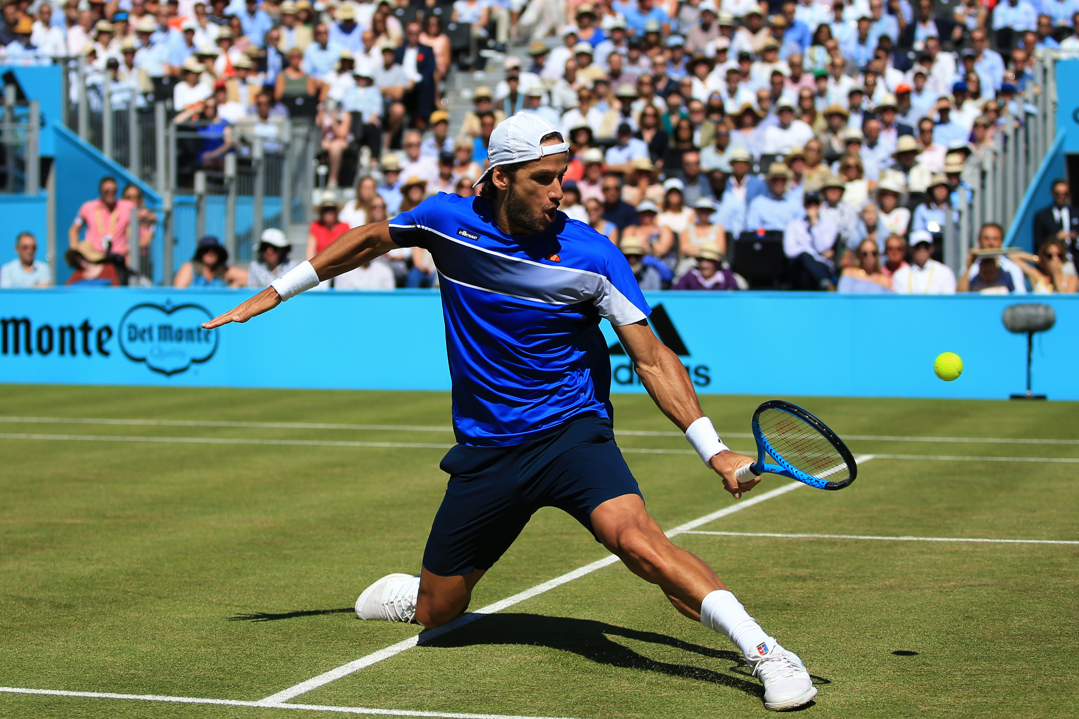 Feliciano Lopez slides into a backhand volley against Nick Kyrgios