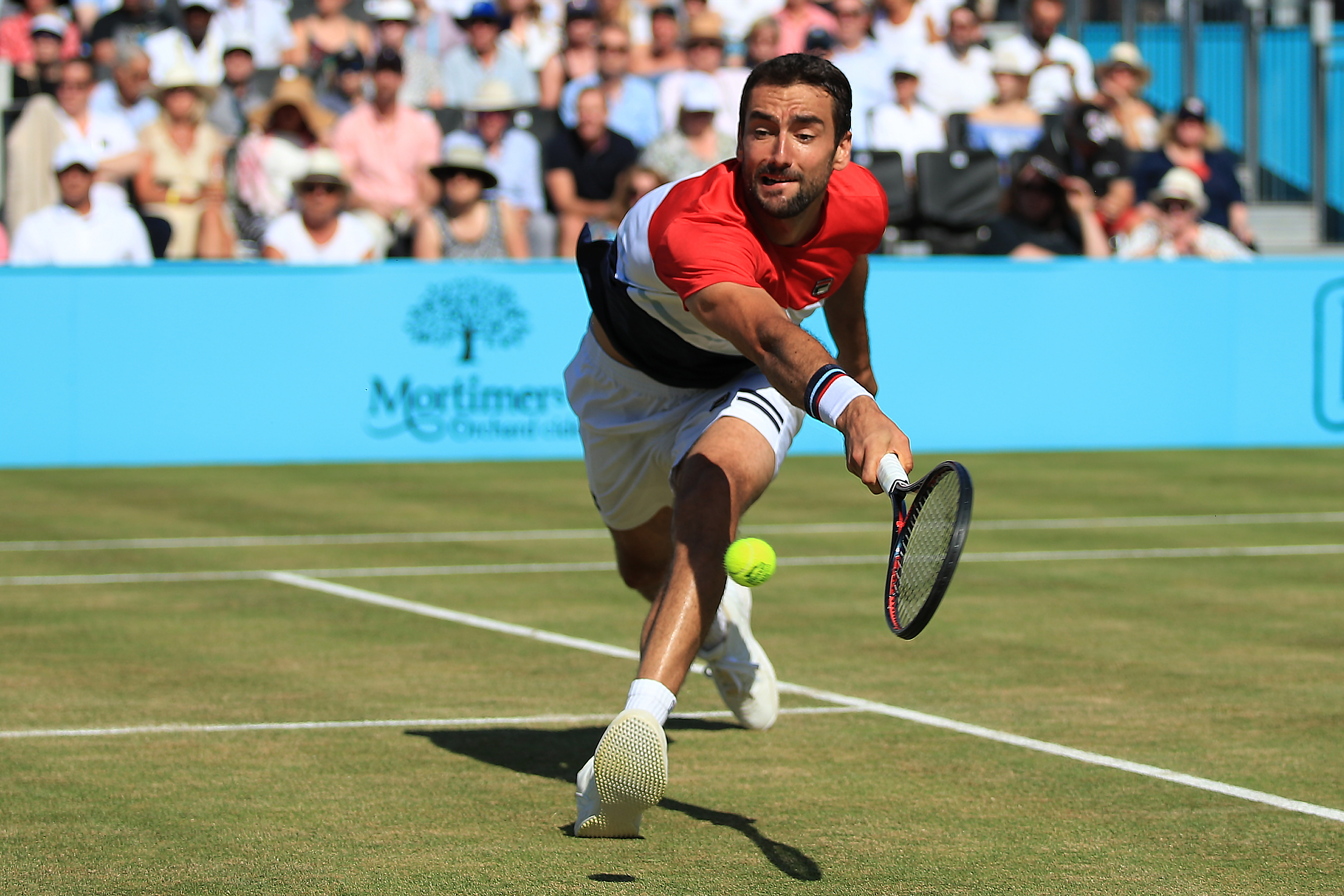 Marin Cilic is put through his pages during the final against Novak Djokovic