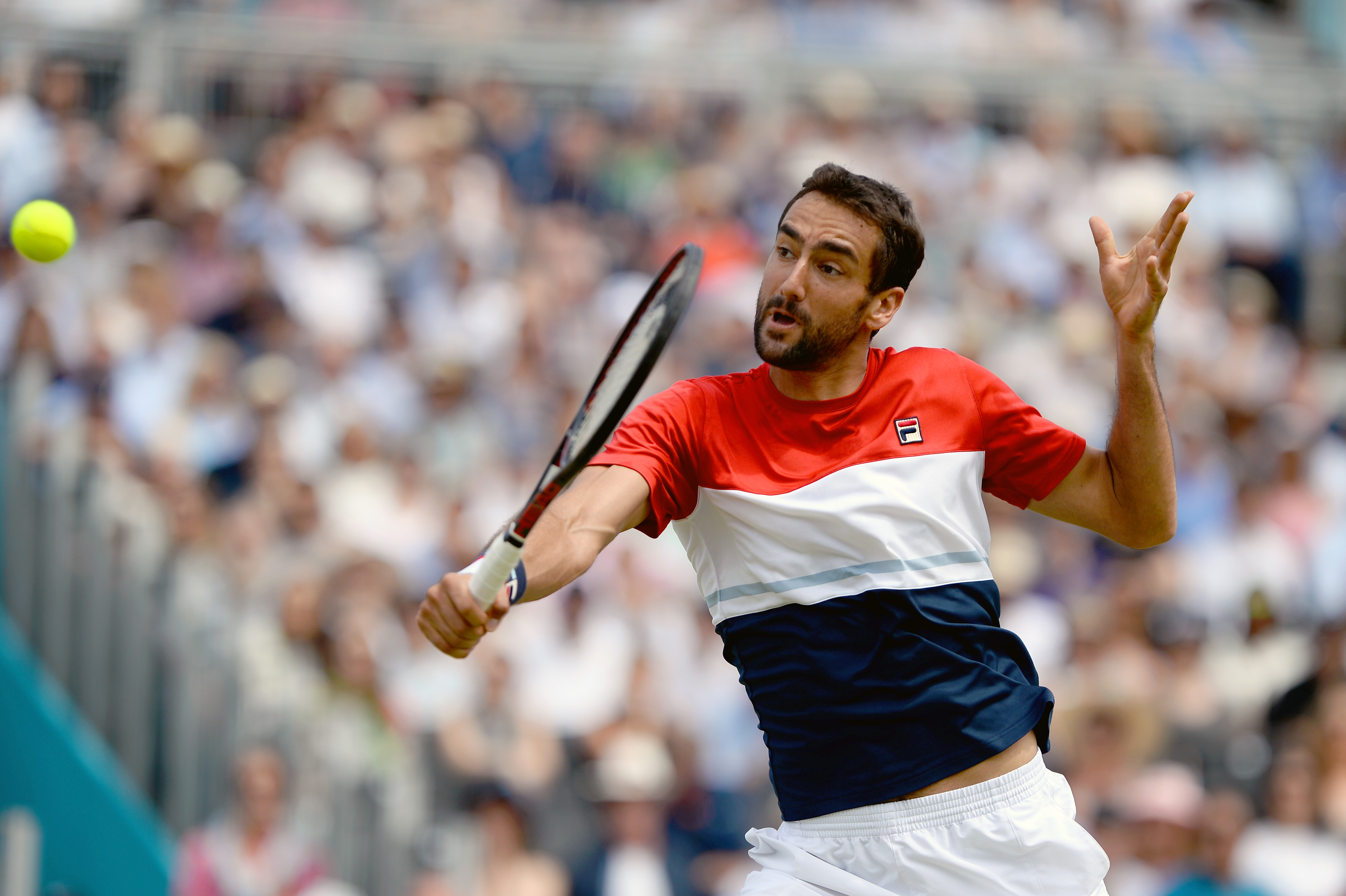 Marin Cilic hits a backhand volley against Nick Kyrgios on Centre Court