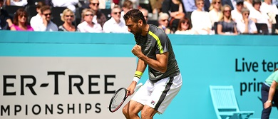 Marin Cilic celebrates a win on day one of the Fever-Tree Championships