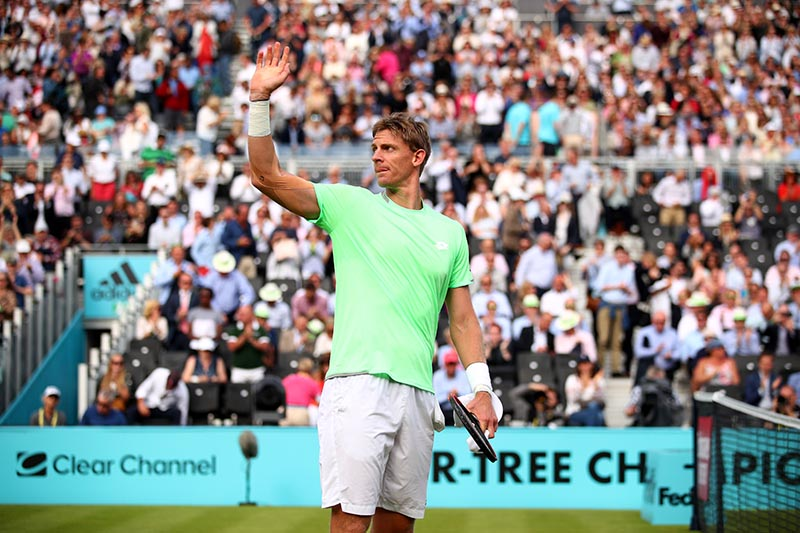 Kevin Anderson celebrates a three set victory against Cameron Norrie