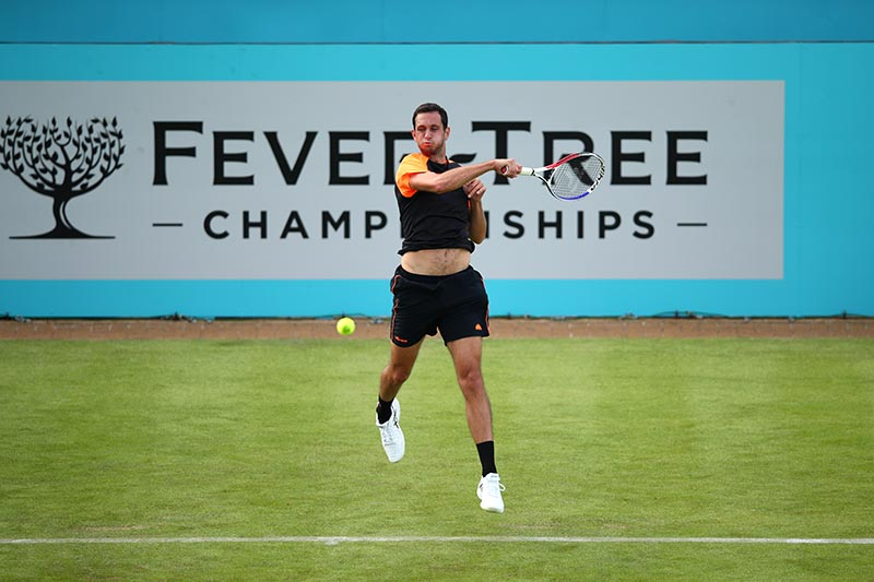 James Ward plays a forehand against Gilles Simon of France