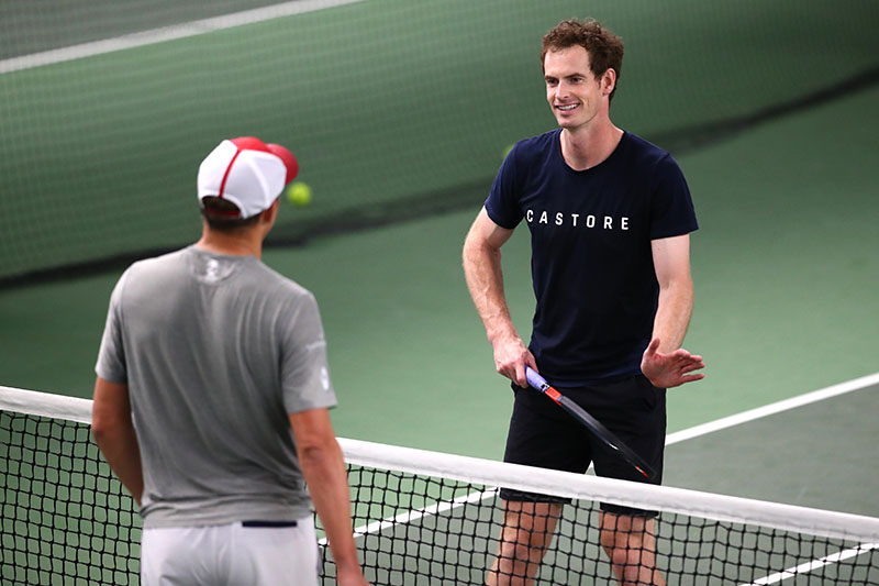Andy Murray chats to Bob Byran during practice indoors
