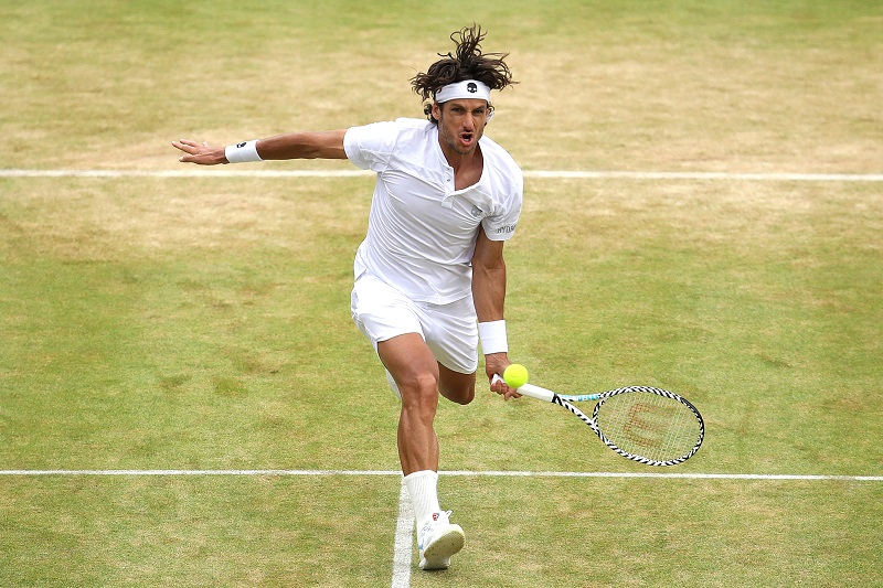 Feliciano Lopez of Spain plays a forehand during the mens singles final against Gilles Simon