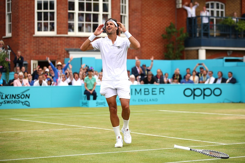 Feliciano Lopez celebrates match point during the mens singles final