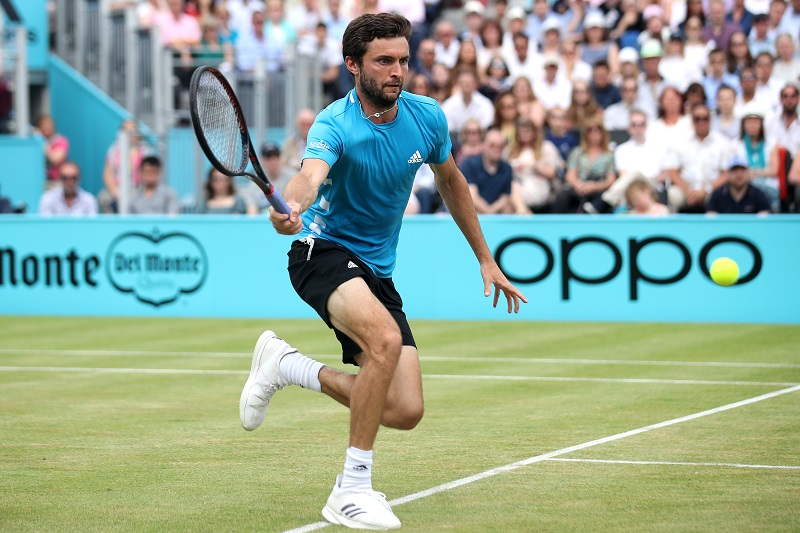 Gilles Simon of France plays a forehand during the mens singles final against Feliciano Lopez