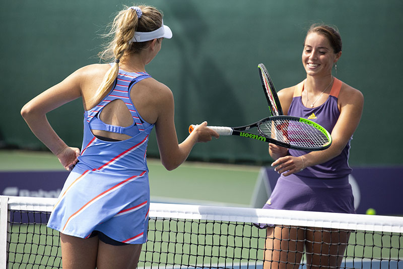 Katie Boulter and Jodie Burrage touch rackets after their match
