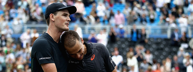Jamie Murray and Bruno Soares embrace after claiming the Aegon Championships 2017 doubles title