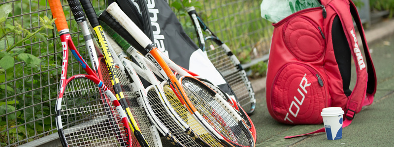 Tennis rackets on a park court
