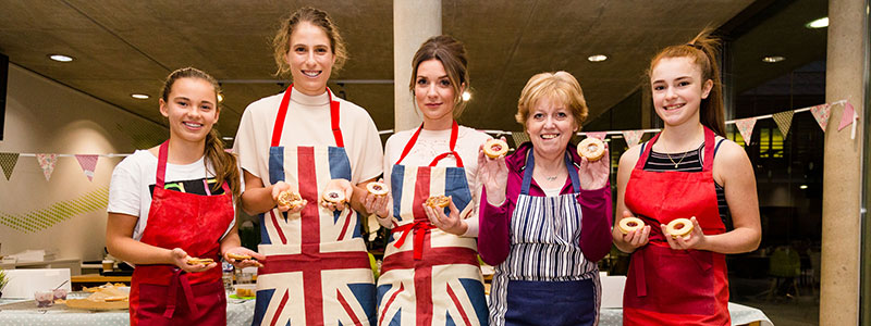 Johanna Konta and Candice Brown in the kitchen with British Tennis Team Members