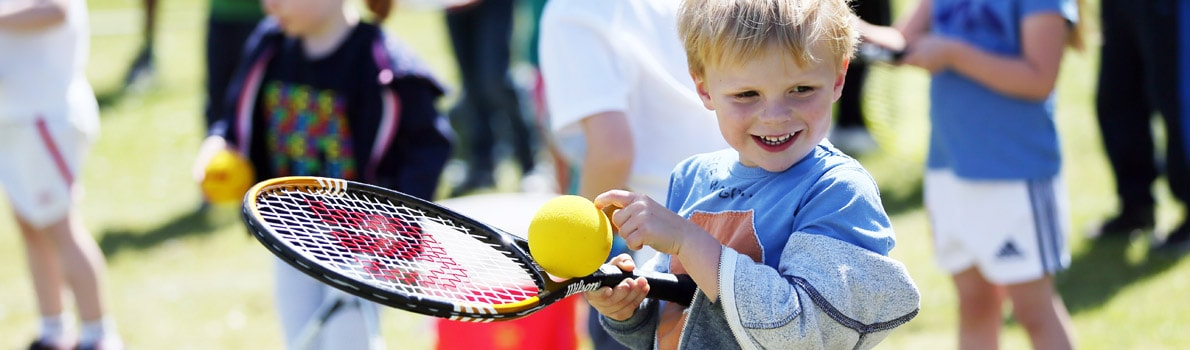 A child playing tennis during Great British Tennis Weekend