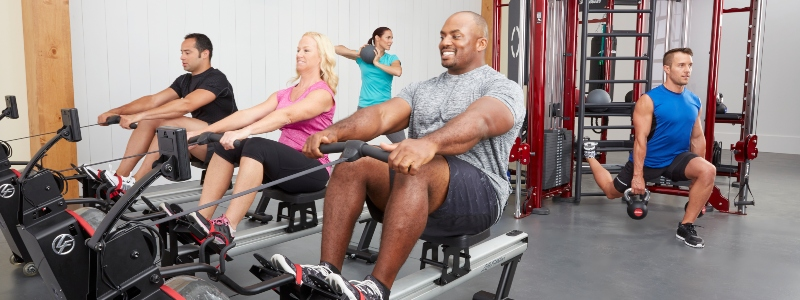 Gym users with Life Fitness equipment