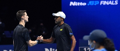Rajeev Ram and Joe Salisbury shake hands at the Nitto ATP Finals