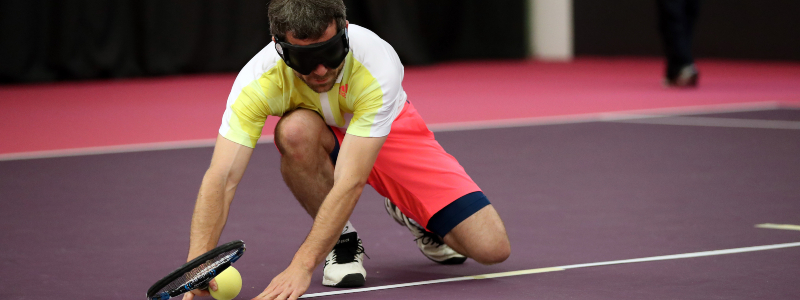 A VI tennis player feels a tactile line