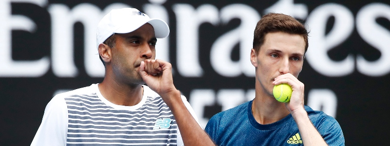 Rajeev Ram and Joe Salisbury discuss a point during the 2021 Australian Open men's doubles final