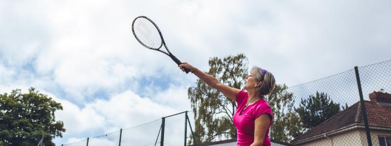 An amateur tennis player hits a serve
