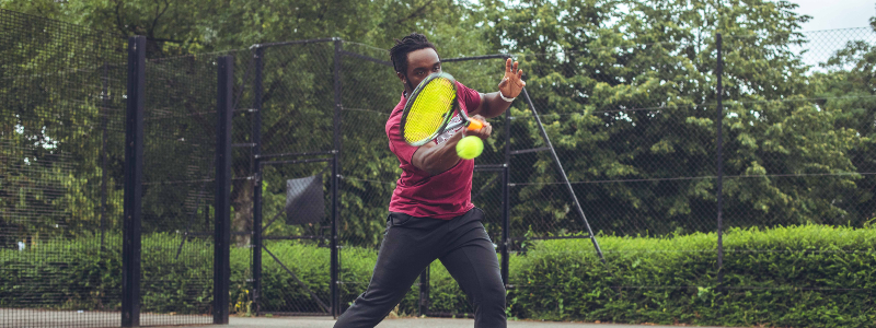 An amateur player hits a forehand