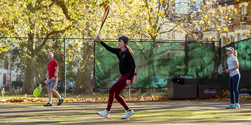 Players enjoying a game of tennis on a park court