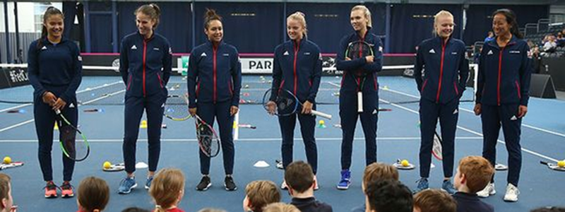 Emma Raducanu with Anne Keothavong and the 2020 Billie Jean King Cup team