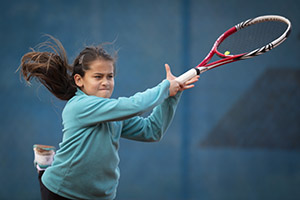 Girl hits a forehand during an LTA Youth Competition