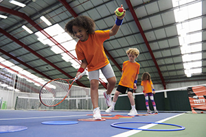 A boy takes part in a LTA Youth Start session