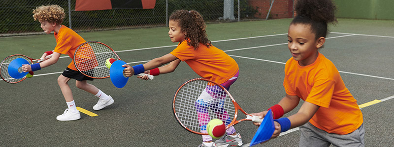 Three participants take part in an LTA Youth Start session