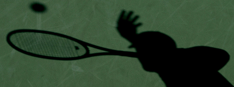 A shadow of a tennis player