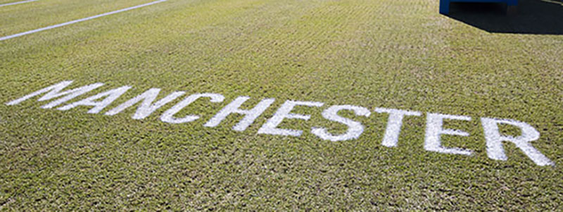 Manchester painted onto the grass at the Manchester Trophy