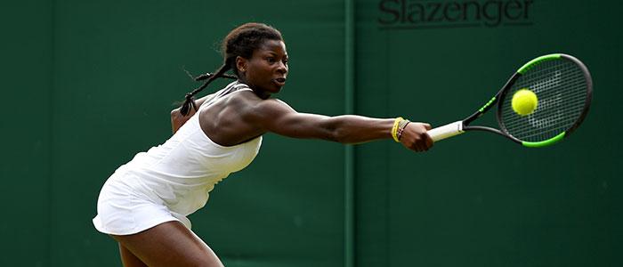 Esther Adeshina plays a backhand at Wimbledon