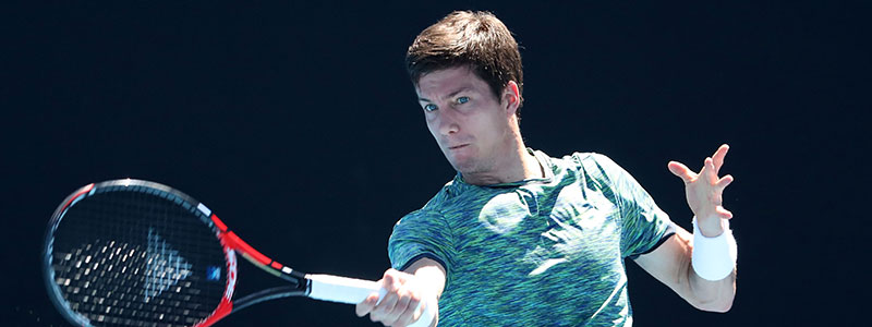 Bedene hitting a forehand during the 2017 Australian Open